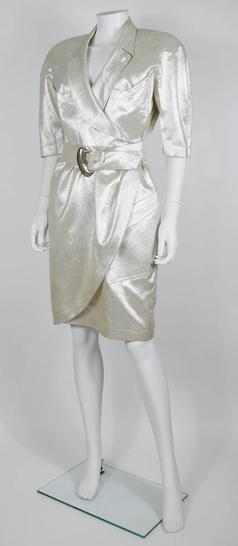 THIERRY MUGLER vintage gold lurex belted wrap dress.  Gorgeous MUGLER's cut.  Half length sleeves. Unlined. Shoulder pads (stitched - but can be removed). Two pockets at the front top. One asymetric pocket at the front lower.  Label reads THIERRY