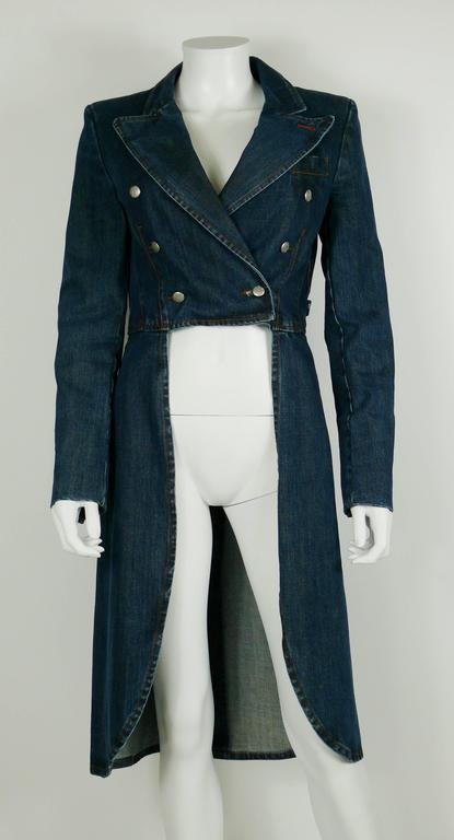 JEAN PAUL GAULTIER gorgeous denim tailcoat.  Double breasted buttons at the front. Open front and wide collar. Exaggerated long tails at the back. Shoulder pads inside lining.  Label reads JPG Jean's.  Size label reads : I 40 / USA 6 / F 36 / GB 10