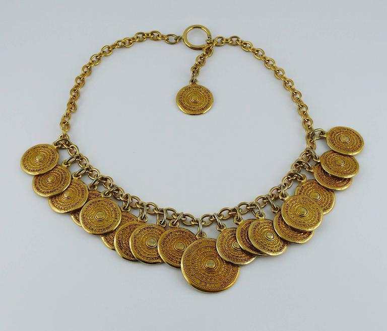 "YVES SAINT LAURENT vintage ""Gypsy"" necklace featuring gold tone chain and coins.