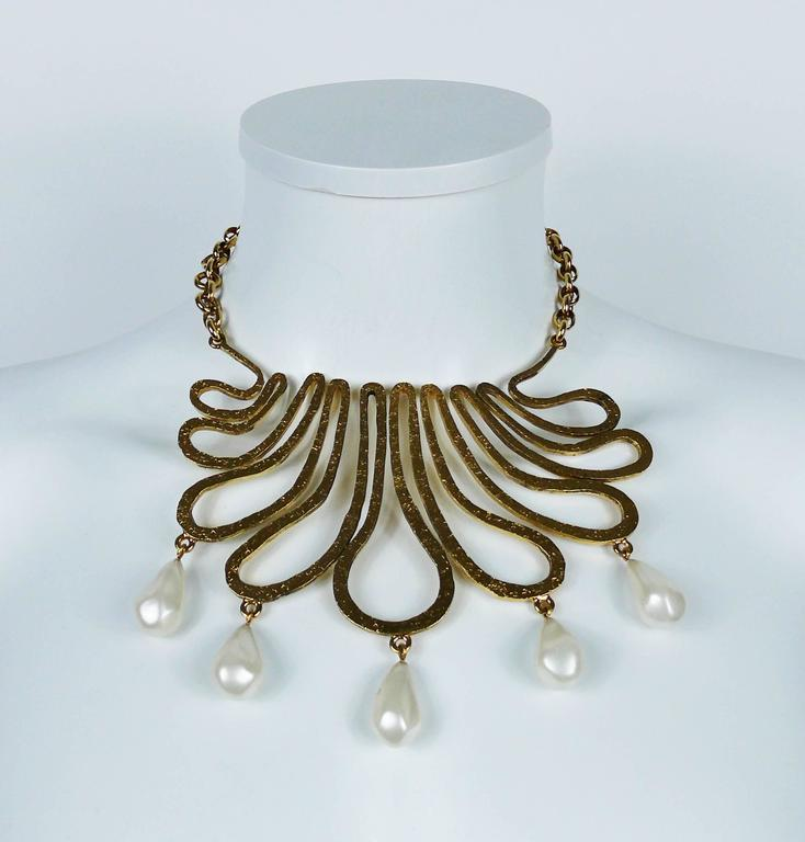 CHANEL vintage gold toned bib necklace featuring a gorgeous arabesque design embellished with five large glass faux pearl drops.