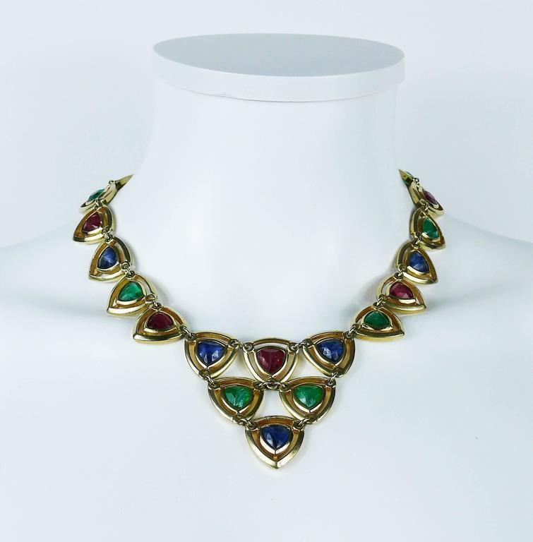 CHRISTIAN DIOR vintage 1980s gold toned necklace and clip-on earrings set featuring a geometric design embellished with faux gemstones (ruby, emerald, sapphire).  Secure clasp closure.  Embossed CHR. DIOR ©.  NECKLACE indicative measurements :