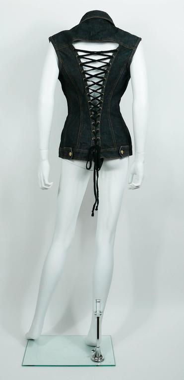 JEAN PAUL GAULTIER vintage black denim corset style sleeveless jacket.  This jacket features : - Beautiful iconic back lace up detail. - Classic collar. - Front button fastening. - Pocket detail at the chest.  Label reads JUNIOR GAULTIER. Made in
