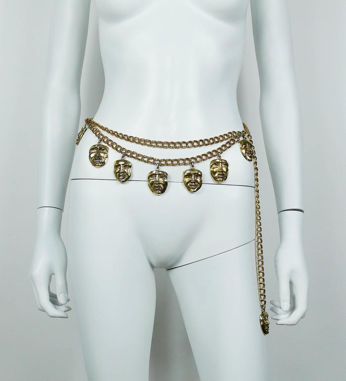 MOSCHINO vintage rare 1990s antiqued gold tone tragedy comedy masks chain belt  May be worn as a necklace.  Hook clasp. Adjustable length.  Embossed MOSCHINO.  Indicative measurements : max. length approx. 96 cm (37.80 inches) / masks approx. 2.9 cm