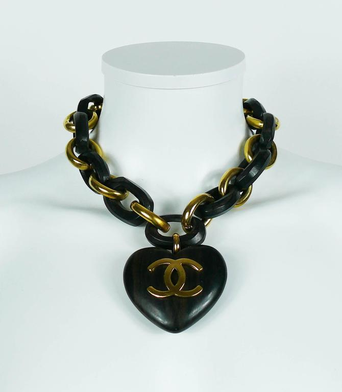 necklaces to carved with pendant iconic find l v jewelry vintage cc id heart at for logo wooden necklace a sale featuring chanel link hard rare massive