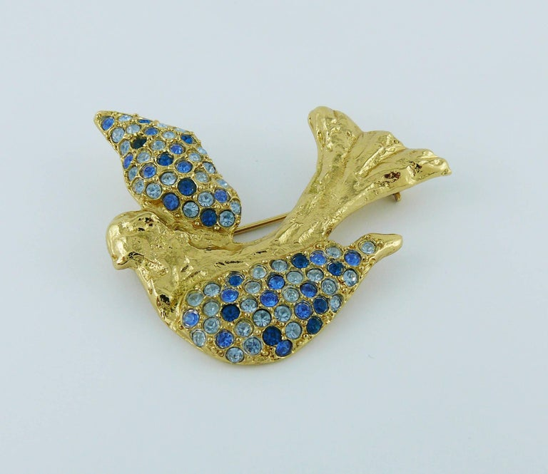 YVES SAINT LAURENT vintage gold toned bird motif brooch embellished with blue shade crystals.  Embossed YSL Made in France.  Indicative measurements : max. height approx. 5 cm (1.97 inches) / max. length approx. 5 cm (1.97 inches).  JEWELRY