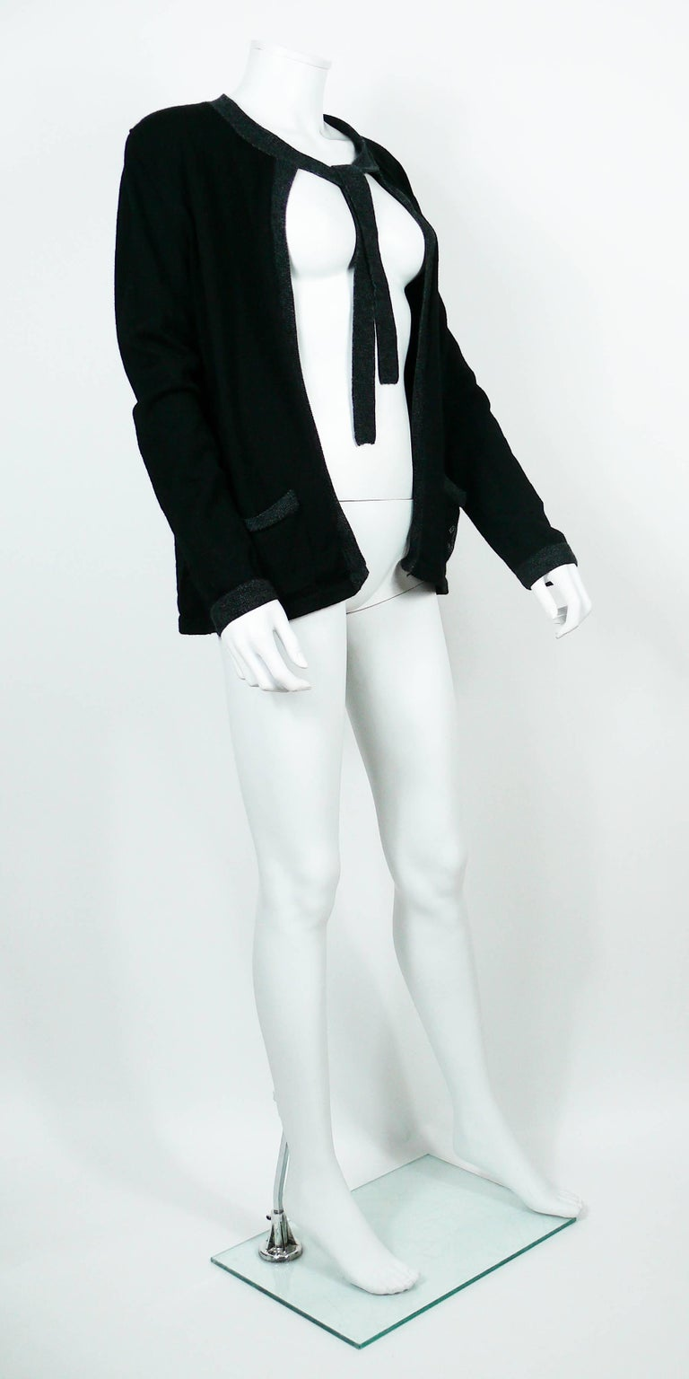 CHANEL Uniform black wool cardigan with grey trim and CC logo detail on left pocket.  Please note this item was original part of a CHANEL employee uniform.  Label reads CHANEL UNIFORM. Made in China.  Size tag reads : XL. Please refer to