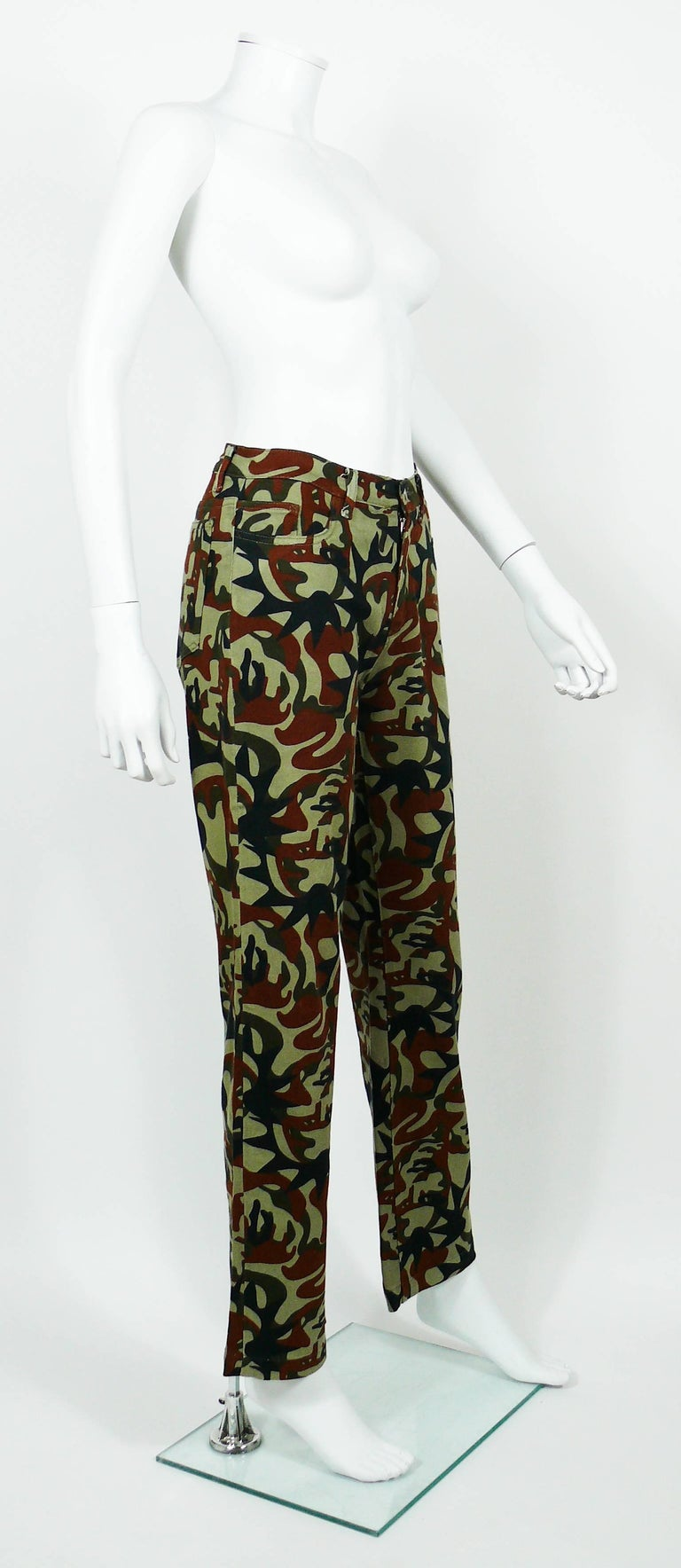 JEAN PAUL GAULTIER vintage pants trousers featuring a camouflage design with faces.  These trousers feature : - Stretchy fabric. - Front zip closure. - Front and back pockets. - Belt loops and signature brand loop at the back.  Label reads JPG
