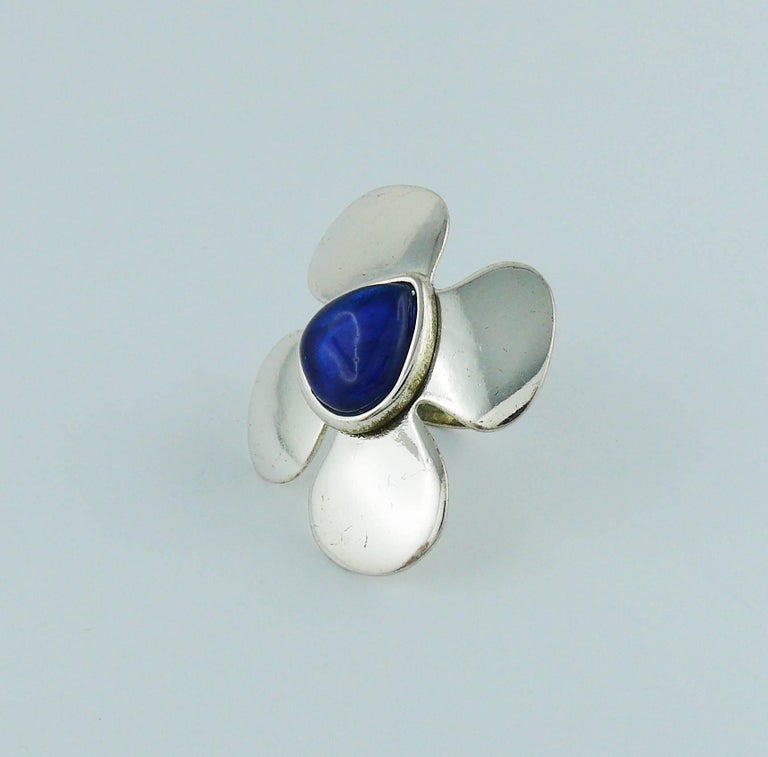 6783ef1abb97 YVES SAINT LAURENT vintage silver toned ring featuring a large stylized  flower design with a sapphire