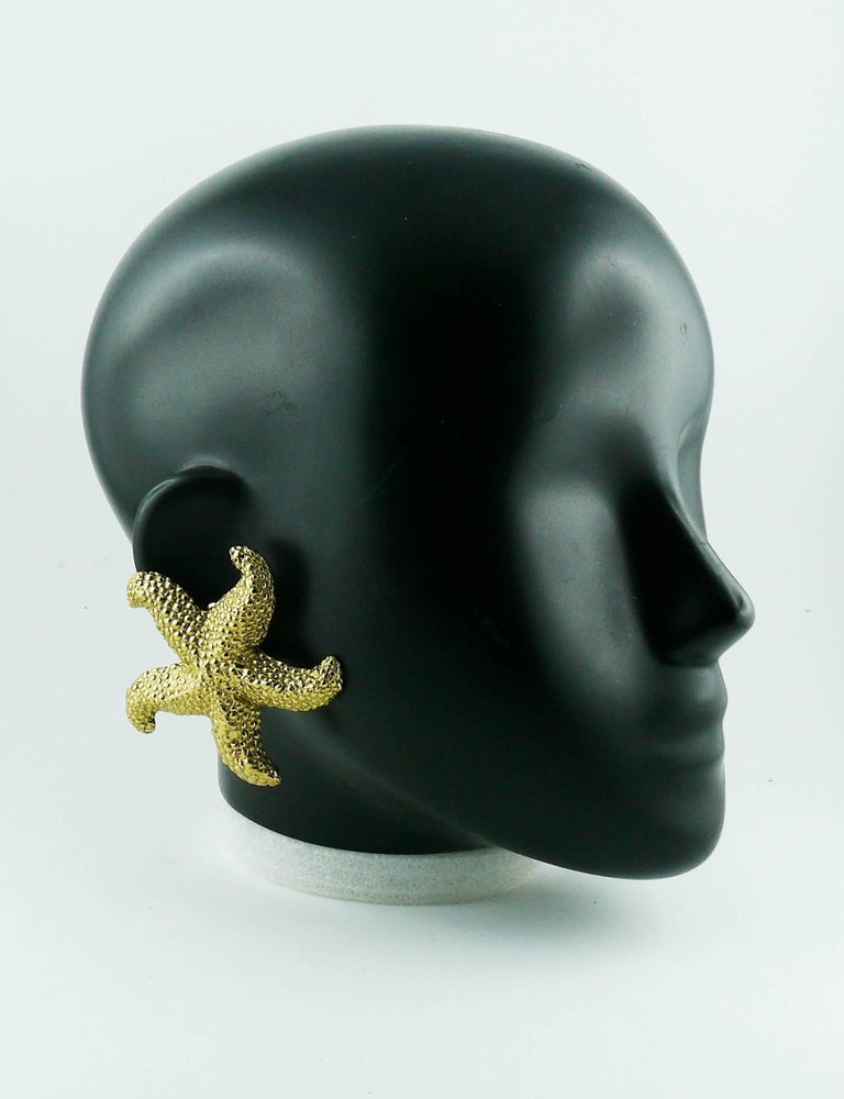 06fd1b47291 YVES SAINT LAURENT vintage massive textured gold tone clip-on earrings  featuring a starfish design
