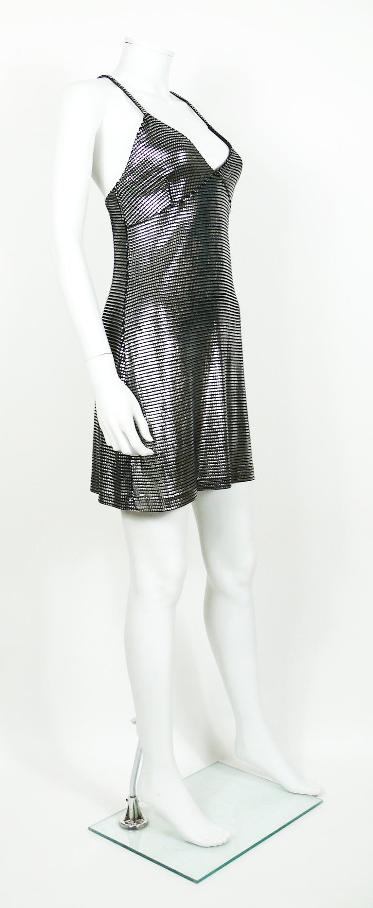 PACO RABANNE sexy silver foil grid mini dress.  Top surface is silver foil printed creating a metallic chain mail effect on a black knit spandex base.  Cross back shoulder straps.  Label reads PACO RABANNE Paris.  Missing size tag. Please double