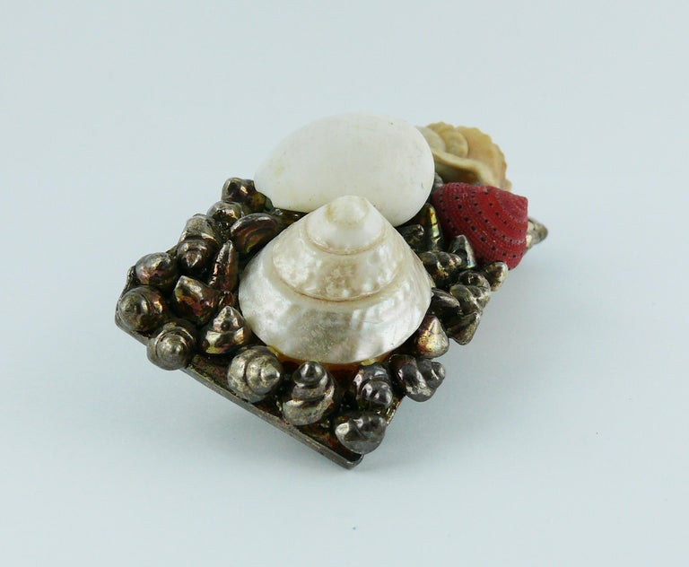 CHANTAL THOMASS vintage solid, rigid and concave hair barrette featuring seashells in an antiqued silver toned setting.  Clasp closure works very well.  Embossed CHANTAL THOMASS.  Indicative measurements : length approx. 8.7 cm (3.43 inches) / width