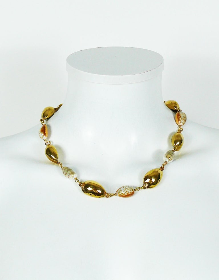 8e05ef7520a YVES SAINT LAURENT necklace featuring gold toned and natural seashell  links. Created by French Parurier