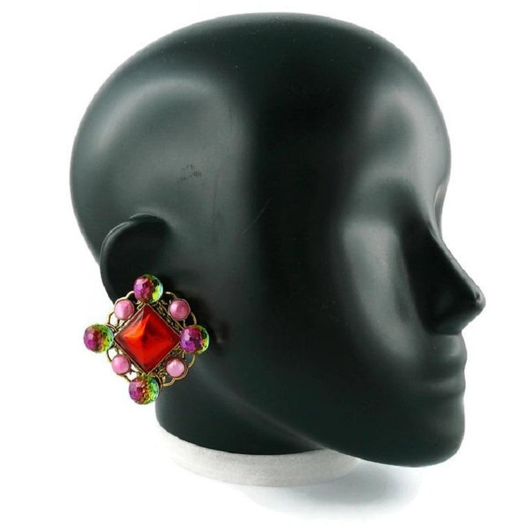 Yves Saint Laurent Rive Gauche vintage massive clip-on earrings featuring iridescent glass balls, pinks glass cabochons and a large reg glass center in an antiqued gold tone openwork setting.  Embossed Yves Saint Laurent Rive Gauche (only one