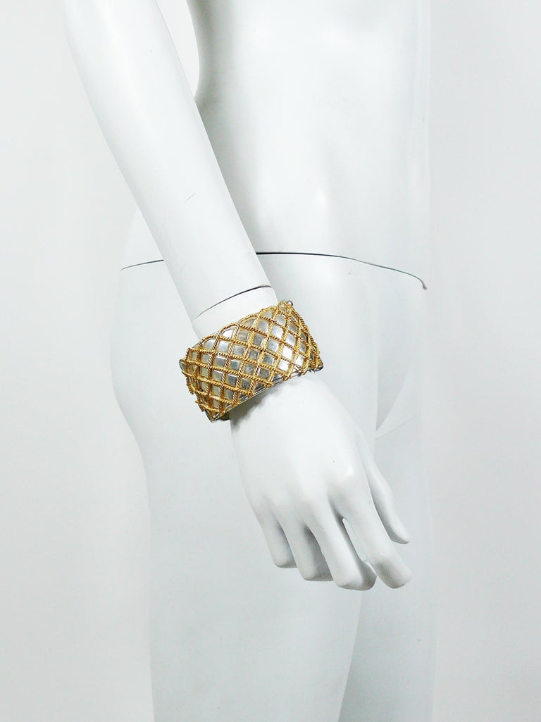YVES SAINT LAURENT vintage two tone cuff bracelet featuring a grid design.  Embossed YSL Made in France.  Indicative measurements : inner length approx. 6.1 cm (2.40 inches) / inner width approx. 5.1 cm (2 inches) / height approx. 4 cm (1.57
