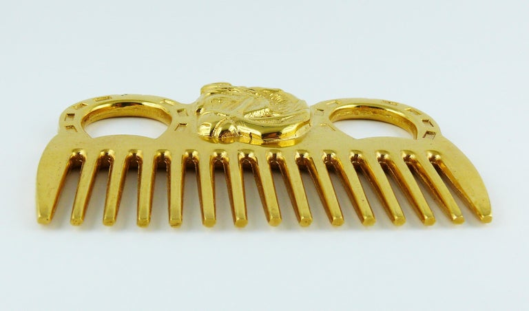 HERMES vintage gold toned horse comb featuring an equestrian design at front.  Embossed HERMES.  Indicative measurements : max. length approx. 9.8 cm (3.86 inches) / max. width approx. 6.8 cm (2.68 inches).  JEWELRY CONDITION CHART - New or never