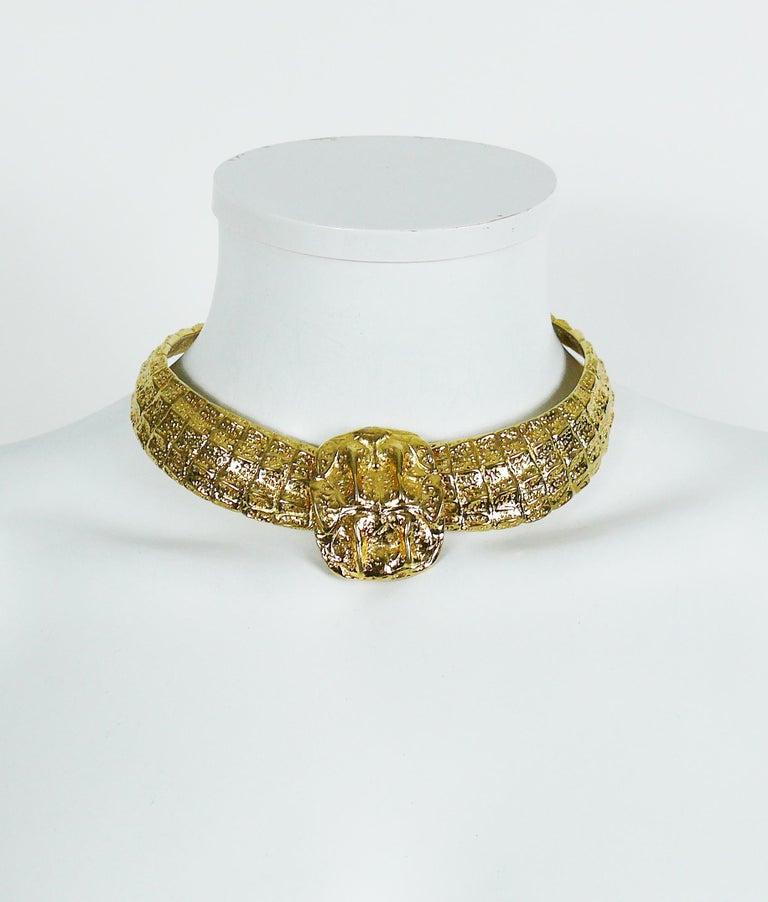 66df47e19ad YVES SAINT LAURENT vintage gold toned choker necklace featuring a crocodile  scale design. Hook closure