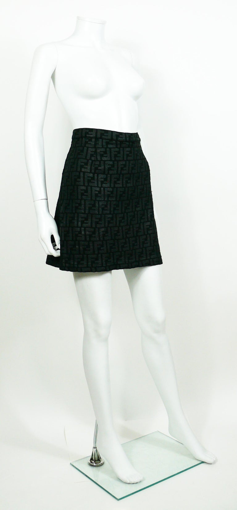 FENDI black and grey all-over logo skirt.  Back zip and button closure.  Label reads FENDI JEANS Made in Italy.  Size label reads : I 46 / USA INCH 32 / D 42. Please refer to measurements.  Composition label reads : 95% Polyamid / 5%