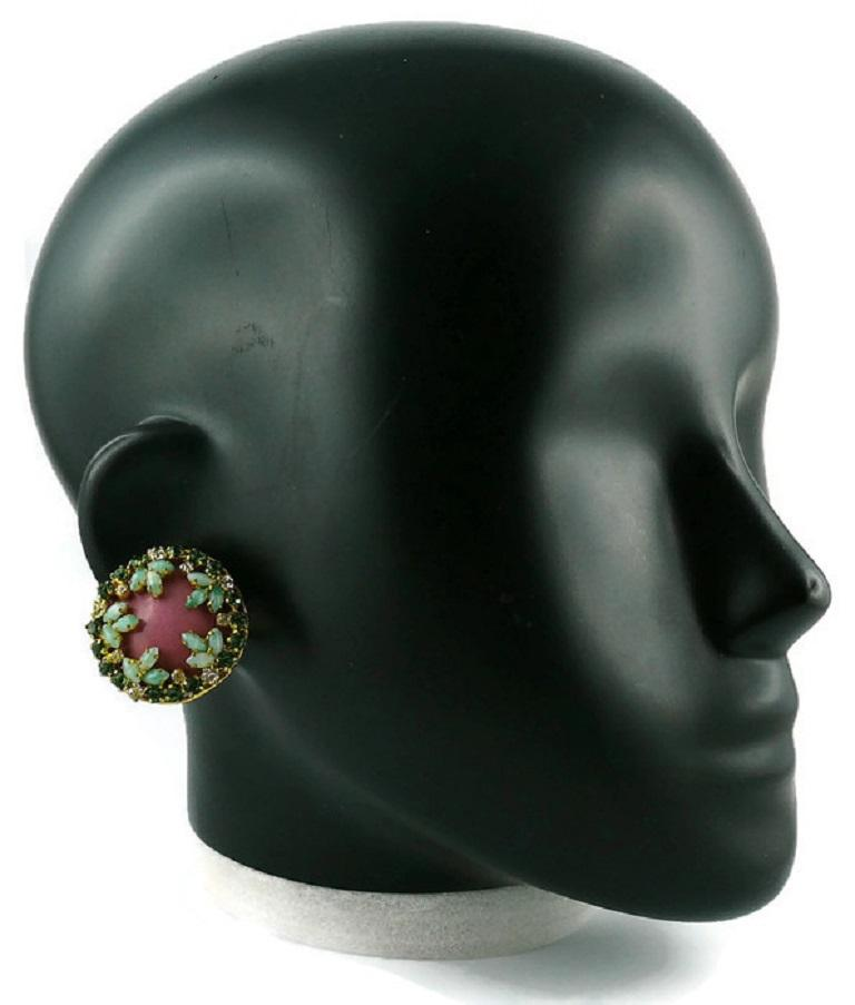 CHRISTIAN DIOR vintage 1960s gold toned clip-on earrings featuring a pink enamel center embellished with green shade crystals/glass cabochons and clear crystals.  Marked CHR. DIOR © Germany. (Please note that one earring is dated 1967 and the other