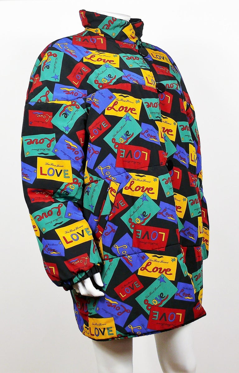 YVES SAINT LAURENT vintage oversized coat featuring a detailed print in vibrant colors with YVES SAINT LAURENT LOVE postcards on a black background.  This coat features : - Multicolor print with YVES SAINT LAURENT LOVE postcards on one side. -