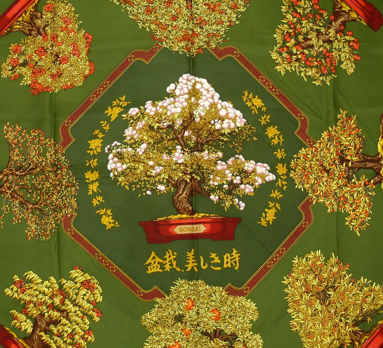 HERMES vintage silk carré scarf LES BEAUX JOURS DE BONSAI featuring bonsai tree motifs on a green background.  First issued in 1991.  Designed by CATHERINE BASCHET.  This scarf features : - Hand rolled borders. - Plump hems. - 100 % silk. -