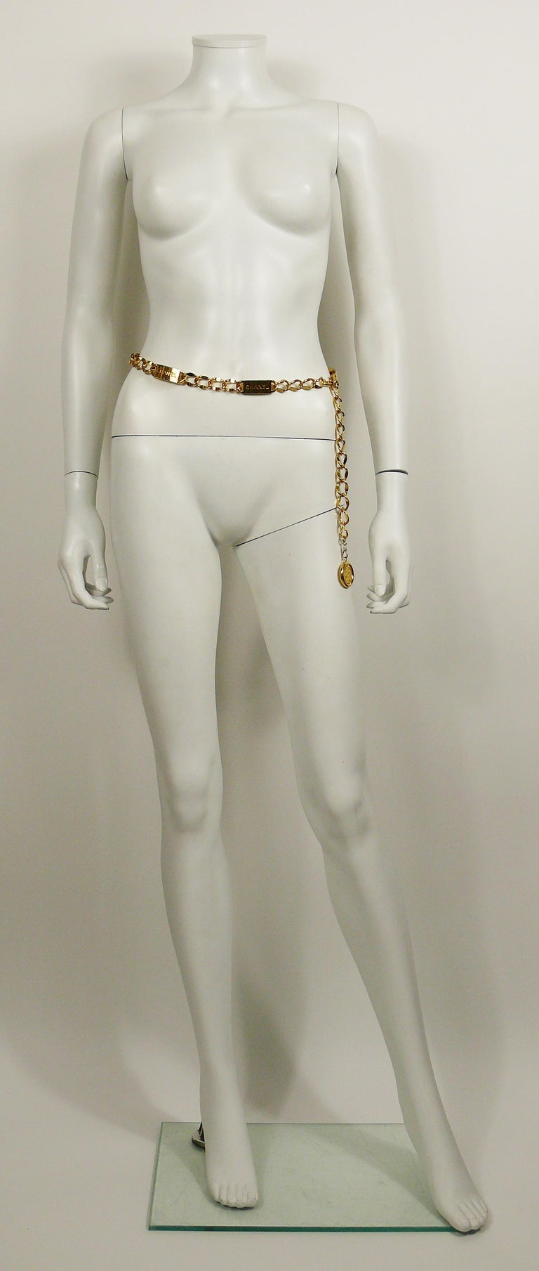 CHANEL vintage gold toned chunky chain belt featuring ID tag style plates embossed CHANEL and a 31 Rue Cambon CC circular coin.  Hook closure.  Adjustable length.  This belt can also easily be worn as a necklace.  Embossed CHANEL on the