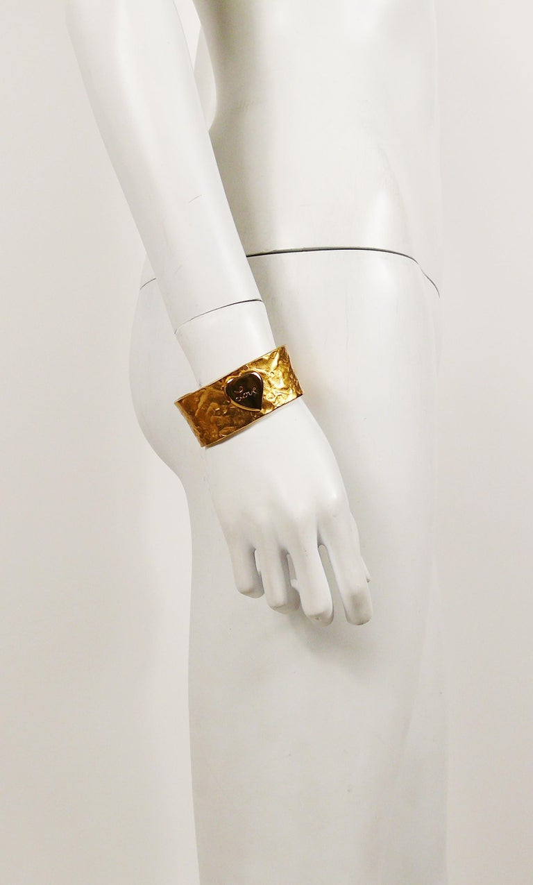 1e8edd7be3c YVES SAINT LAURENT vintage hammered gilt cuff bracelet featuring a heart  centrepiece with engraved LOVE.