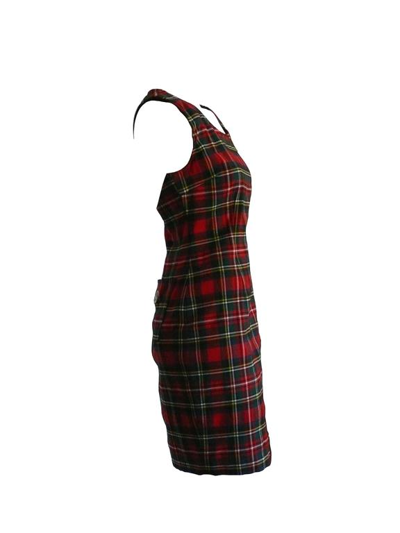 MOSCHINO vintage tartan plaid sheath mini day dress from the 1990s.  This dress is unlined with back pockets and a side zip closure. Peace symbol on one pocket.  Label reads Moschino Jeans Made in Italy.  Color: red / green / blue / yellow /