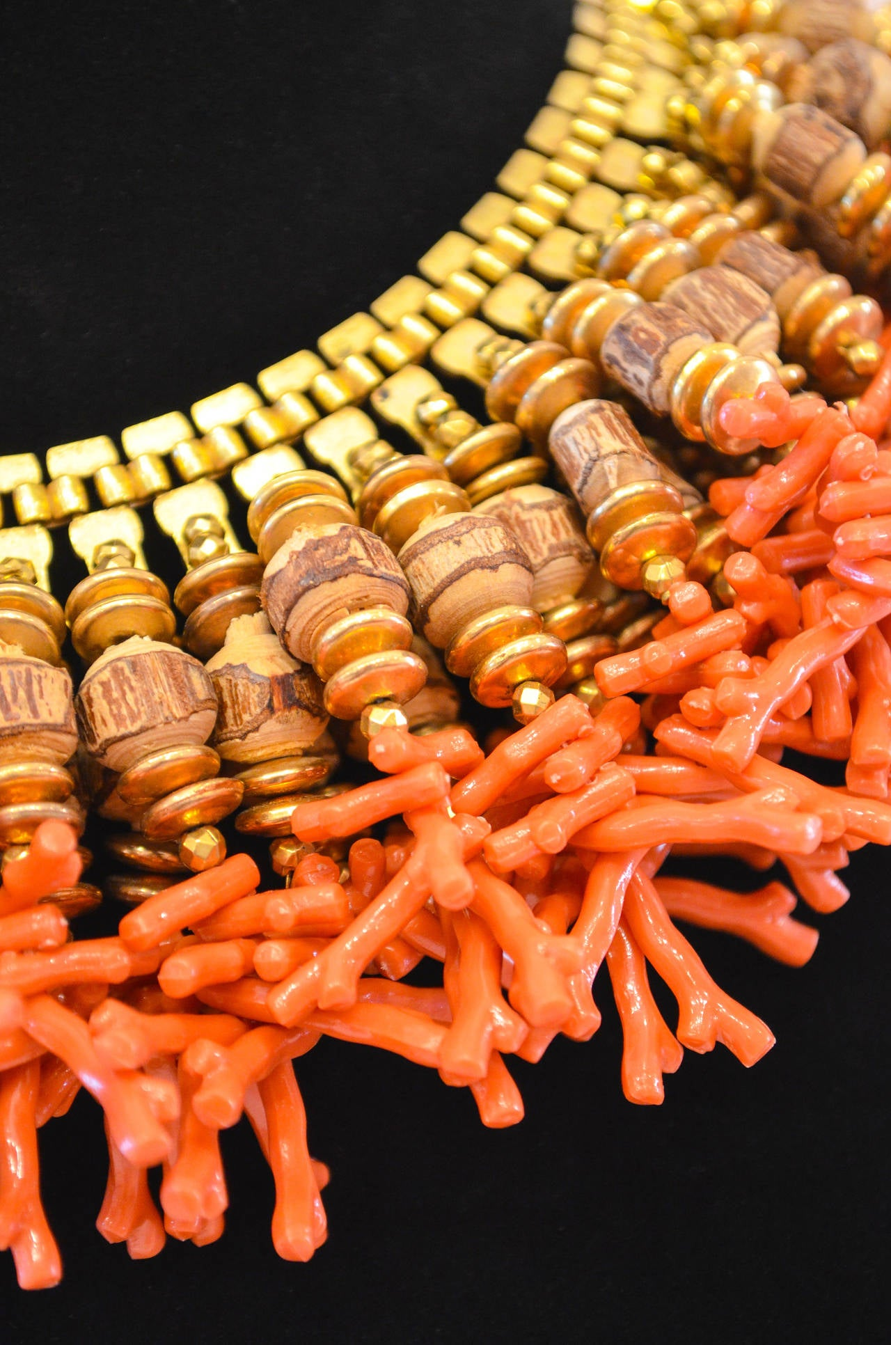 """A superbly chic bib collar necklace designed by Lawrence Vrba who worked for Miriam Haskell from 1970 to 1978. This necklace is a combination of faux coral, wooden beads  and """"gold """" metal discs;  the clasp is signed Miriam Haskell. This is a"""