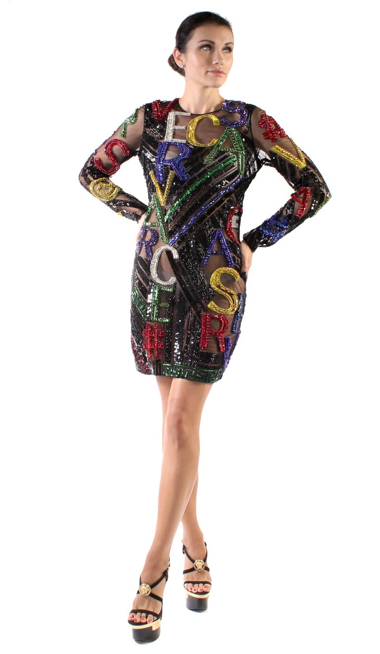 VERSACE   2015 Fall Finalee Dress  Black tulle is fully covered with crystals, beads and sequins.  IT Size  38  Find us on Instagram @exquisitefindscom and see how gorgeous this dress in the video!  Brand new, with tags.  Comes with Versace