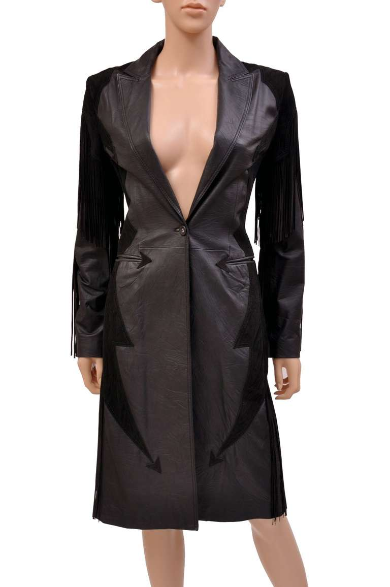 Sumptuous and perfectly tailored, Versace's divine leather coat recalls unstoppable luxury for a supremely chic, of-the-moment look.  The smooth black nappa leather is decorated with delicious dark brown suede and finished with glamorous fringe