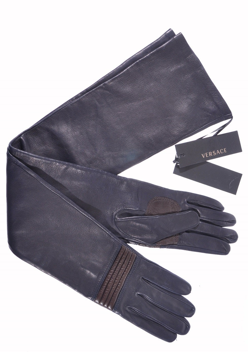 VERSACE gloves  This expertly handcrafted glove will add an element of luxurious Italian style to any outfit. In supple lambskin in delicious dark navy (almost black) color, finished with chocolate quilted leather detail.  Made in Italy.  Size