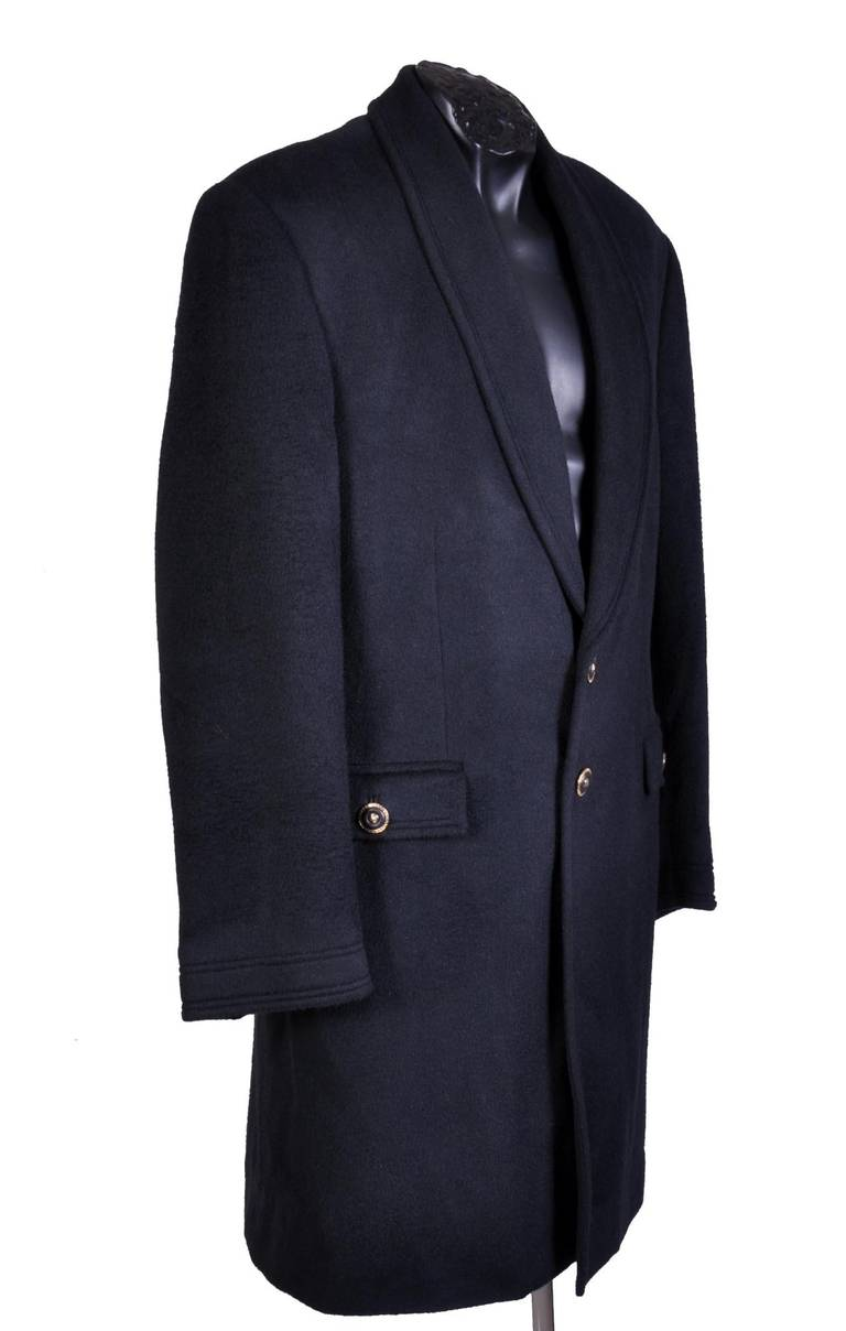 VERSACE COAT  60% wool, 30% angora, 10% cashmere  Fully lined and padded  Detailed with Versace signature buttons and hand-warming pockets.   Very comfortable and extremely luxurious!   Italian size 48, US 38  Please see the