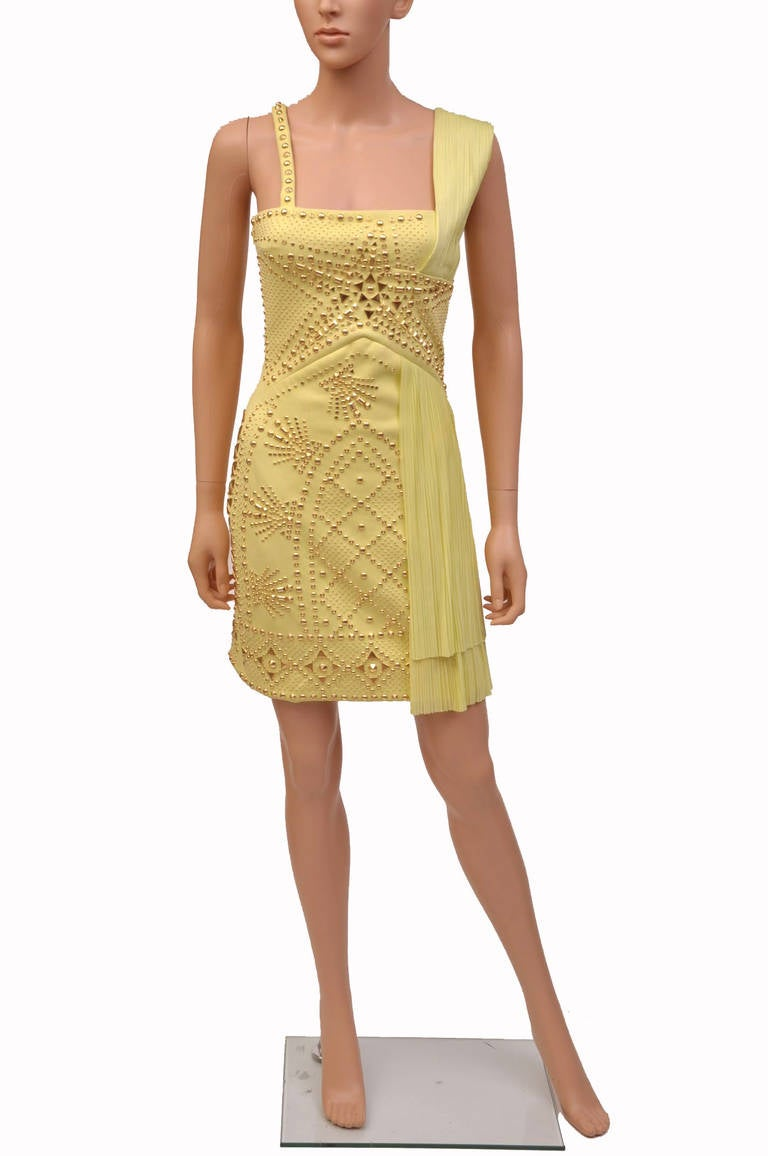 VERSACE  Yellow studded plissé and scuba-jersey dress  Plissé-jersey shoulder strap and overlay plisse panel at side skirt,  geometric studs, fully lined Concealed hook and zip fastening  Fabric1: 48% nylon, 34% polyester, 18% elastane;