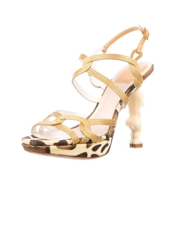 Iconic Christian Dior Fertility Goddess heels  Brown and creme animal print stingray. Gold-tone chain straps, buckle closure.  Condition: Worn ones Measurements: Heels 4.75