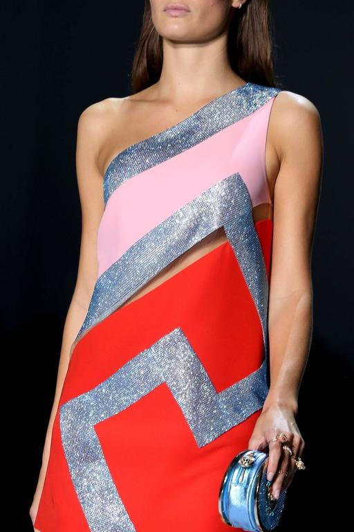VERSACE   Crystal embellished dress  One of the standout pieces from the runway, this red and pastel-pink silk-cady mini dress is saturated with turquoise crystals and spliced with sheer mesh.   Hidden zip closure  IT Size  38   Made in