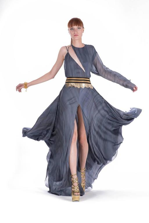 BRAND NEW VERSACE DRESS   The sensational dove grey color, chic design and artfully embellished metal fringe belt - ensure a stunning silhouette.   IT Size  38  Made in Italy