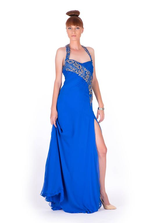 New VERSACE EMBELLISHED ROYAL BLUE CHIFFON SILK GOWN  Impress at any formal function with this elegant creation by Versace. The royal blue dress was fashioned in Italy with luxurious silk chiffon. An artfully embellished body with an open back,