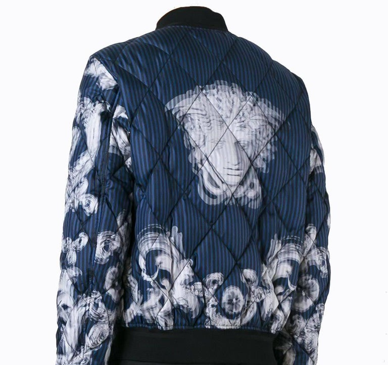 VERSACE  'Lenticular Foulard'  BOMBER JACKET   This bomber jacket from Versace featuring iconic print and quilted 100% silk, cotton ribbed neck, hem and cuffs and silver front zip fastening/  Tonal stitching.   Shell: 100% silk.   Inner: 100%