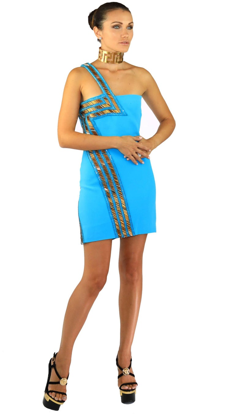 Versace   Blue silk dress One shoulder design Sequin and bead embellishments, fully lined  Concealed hook and zip fastening  100% silk  Dry clean  Made in Italy.  IT Size 38 - US 2  New, with tags
