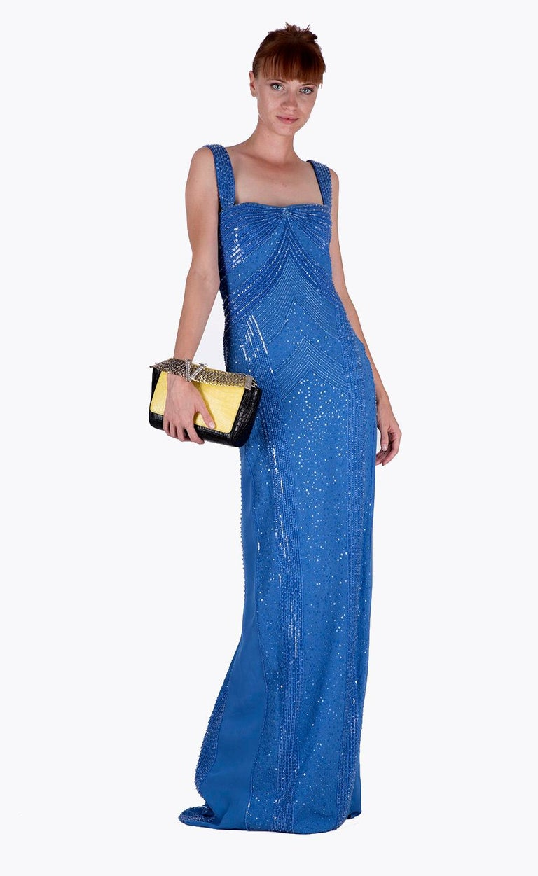 Never one to shy away from beadwork and embellishment, Versace recreates a dress fit for a princess. A dreamy vision in blue this floor-sweeping gown is bound to get prince charming's attention. Be the belle of the ball at your next special