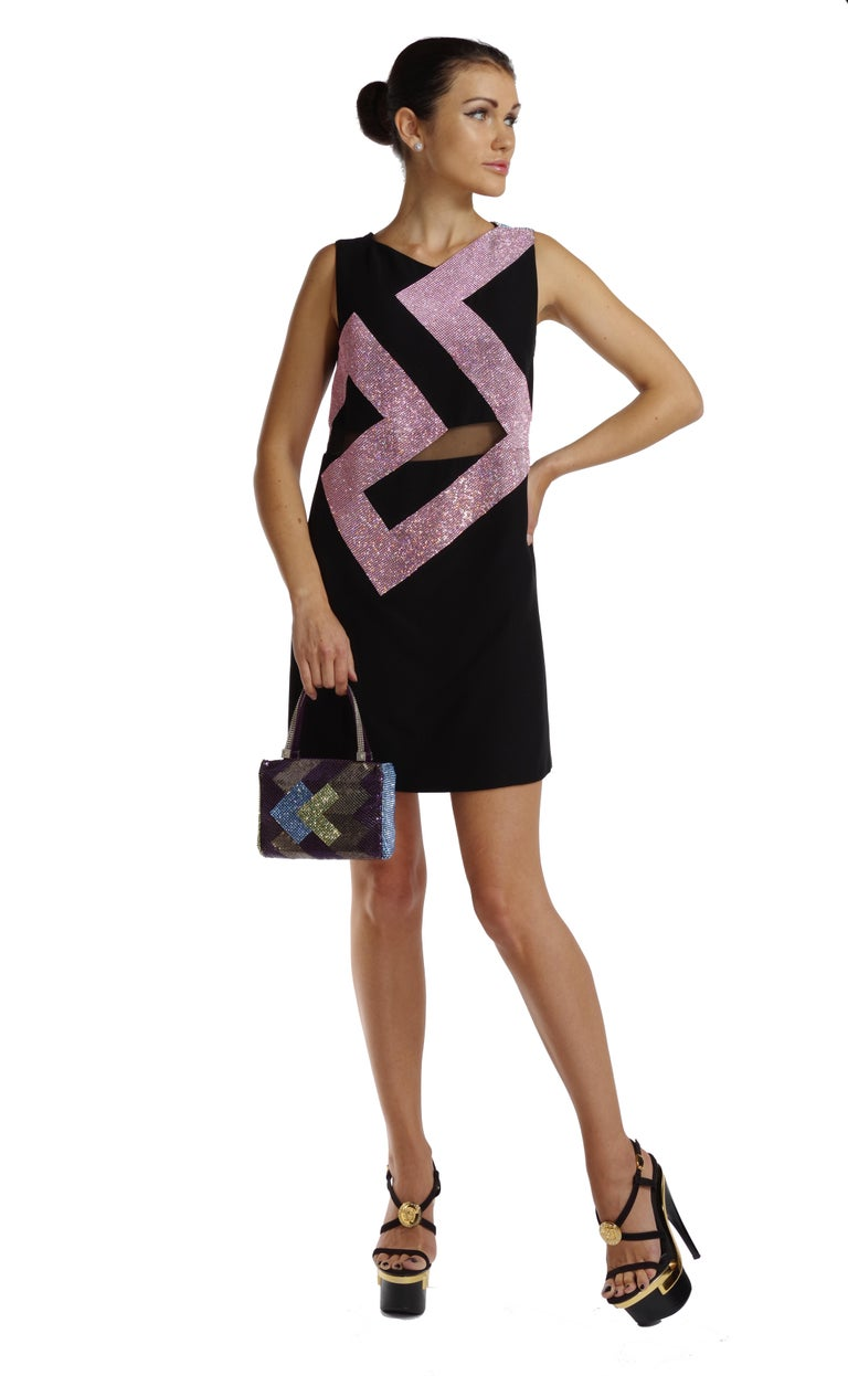 VERSACE   Crystal embellished dress  Versace's black silk-cady dress sings high-octane glamour.  It's cut to the label's signature body-con silhouette with a sheer mesh waistband and  pink and blue Swarovski crystal embellishment  adding real