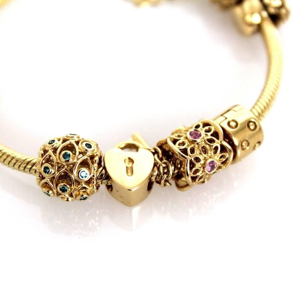 pandora gold 8 piece diamond embellished charm bracelet