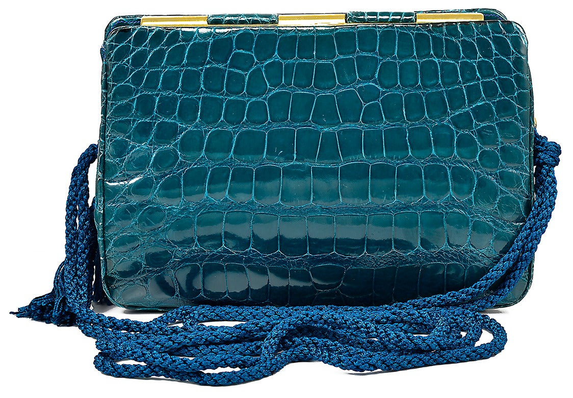 Gorgeous emeral green Judith Leiber alligator clutch bag with satin detachable strap.