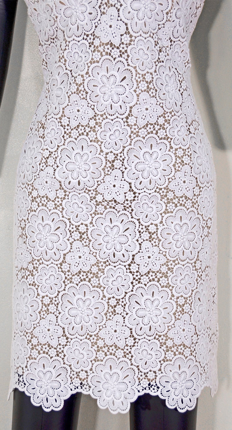 Beautiful Micharl Kors white lace sleeveless dress, perfect for any special occasion this summer. Size 6-8. Excellent condition.