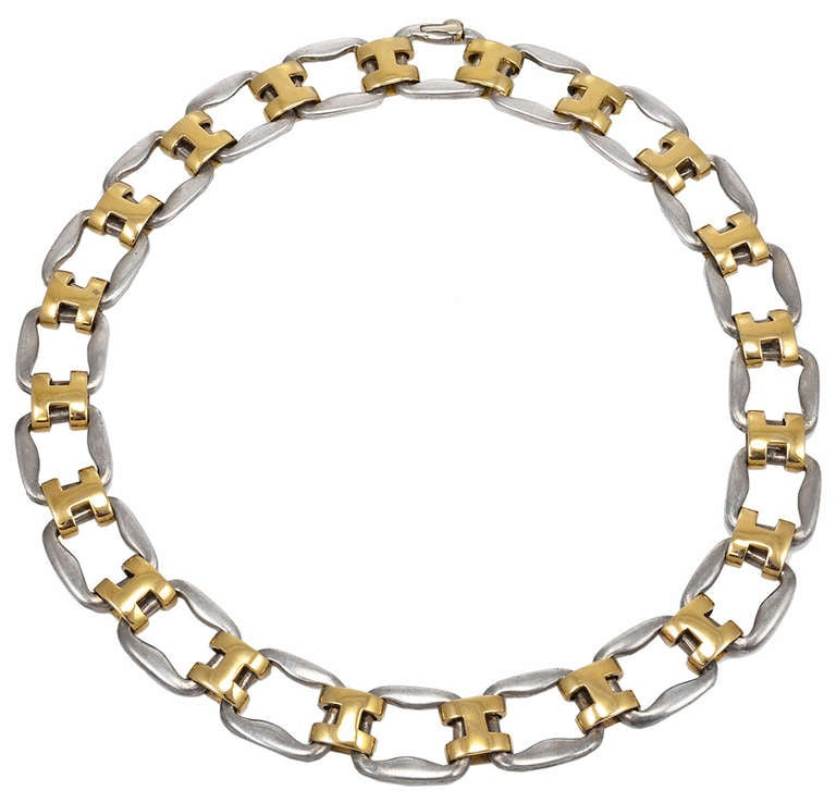Gorgeous, classic, vintage Hermes sterling and solid 18K yellow gold necklace.  16