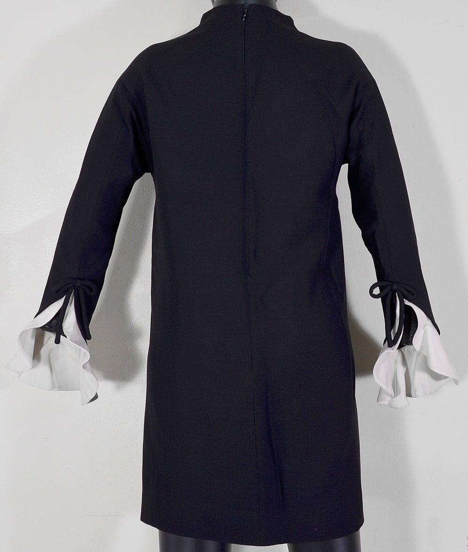 Gorgeous Valentino black top with white ruffle cuffs. So chic!!! Size 38/6 in pristine condition.