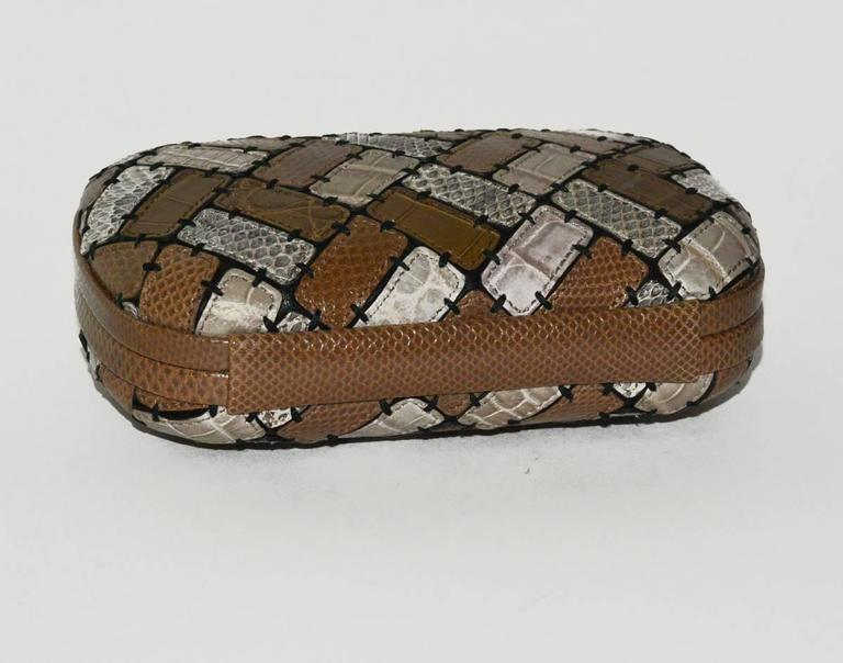 Unique and Limited Edition (47/60) Bottega Veneta Patchwork crocodile and lizard exotic skin Knot bag. It has a plaque inside depicting 47/60.  It is a one of a kind bag, absolutely magnificent. Retail replacement at BV is $5200.00 USD. Pristine