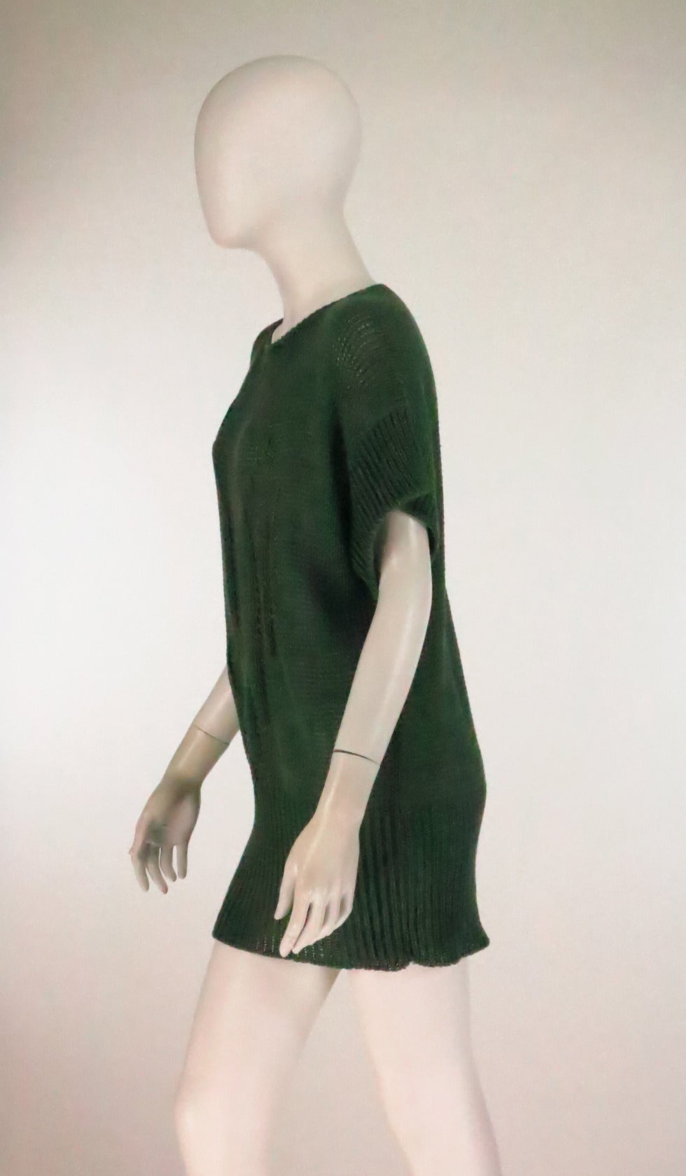 Chunky knit pull on sweater tunic in pine green rayon...Round neck with cropped kimono sleeves...Ribbed hem...Abstract intarsia knit design at sweater front...unlined...Jil Sander from the 1980s...In excellent condition...Fits like a
