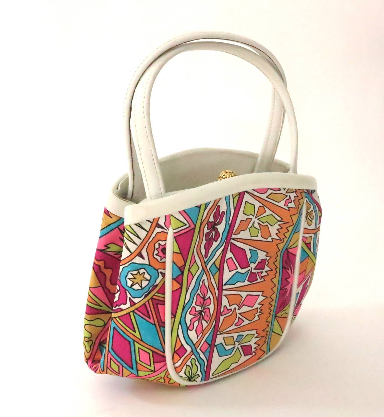 Bright print silk hand bag designed by Emilio Pucci and made by Jana...Cream leather double handles, trims and partial lining...The bag has a center compartment that closes with a gold filigree snap clasp, there are open compartments on either