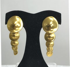 Robert Lee Morris Articulated matte gold earrings 1980s
